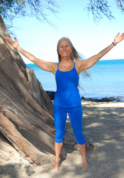 Yoga teacher, Calley O'Neill on the Big Island of Hawaii teaching seaside yoga at Lava Lava Beach Club, Waikoloa Beach Resor